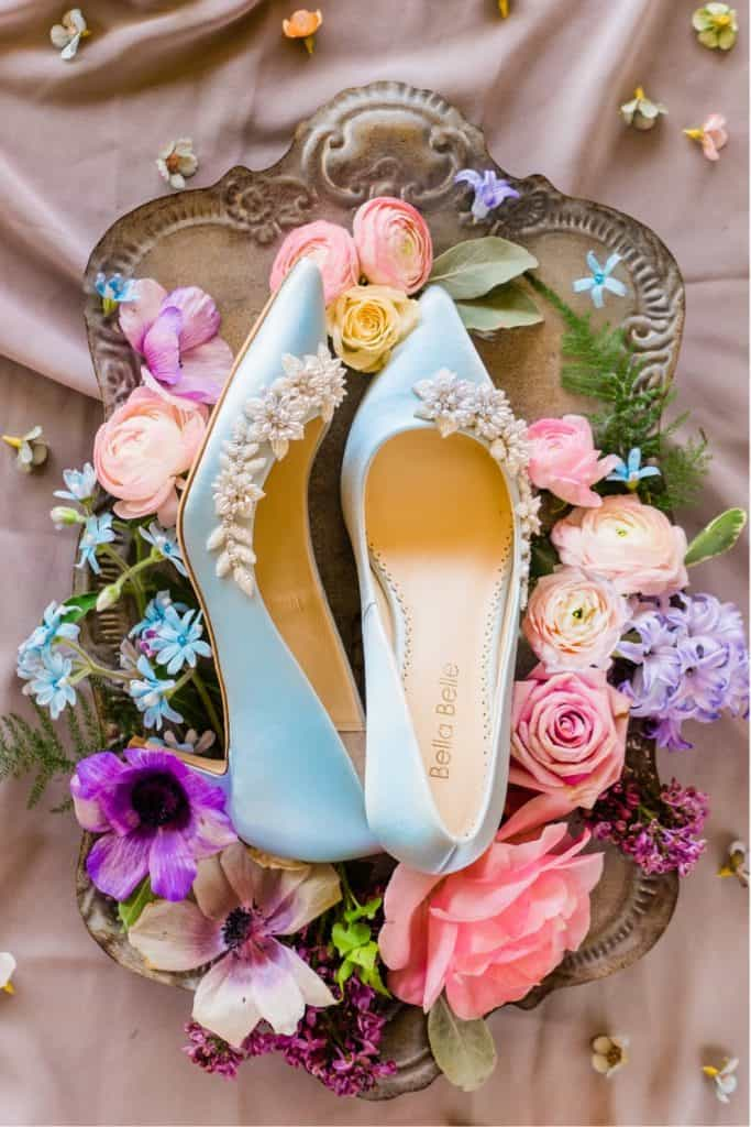 blue bridal shoes and flowers