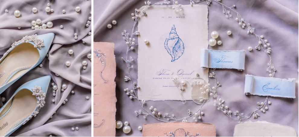 coastal inspired wedding invitation surrounded by pearls and blue bridal shoes
