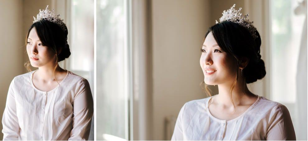bride sitting near window light and smiling