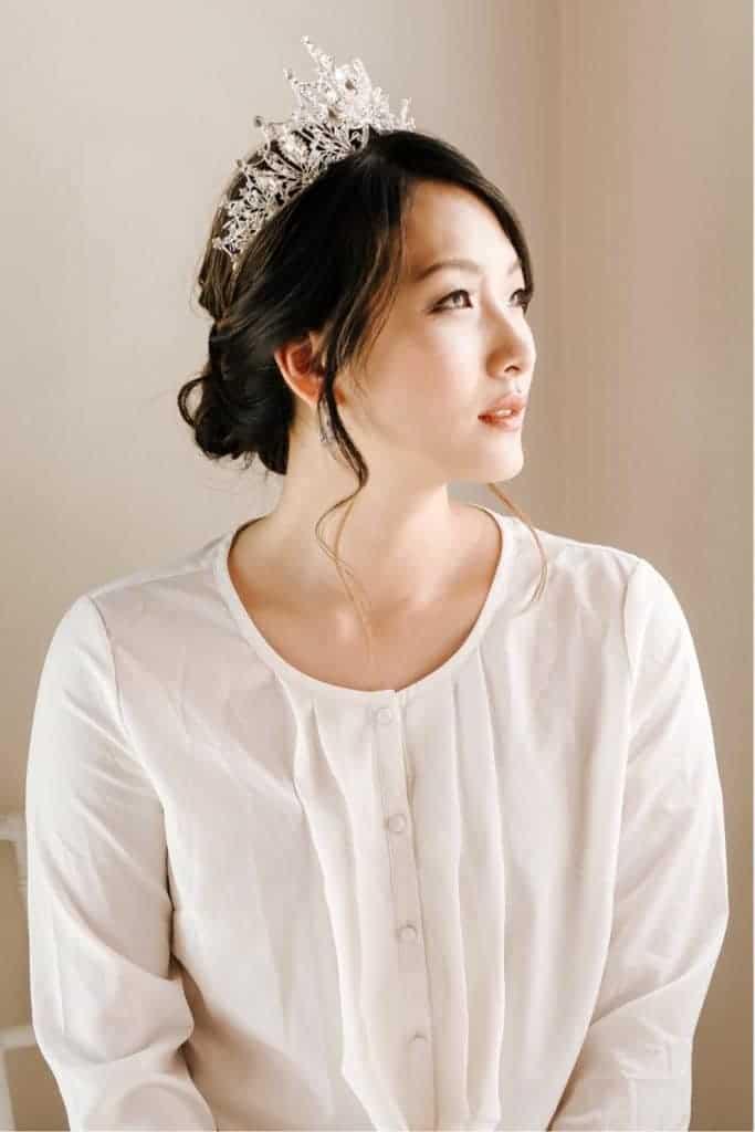 bride wearing pearl crown