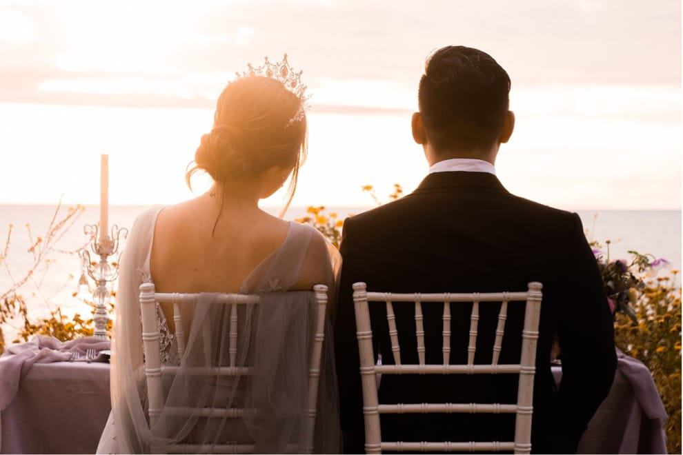 bride and groom have romantic table for two at oceanside California elopement